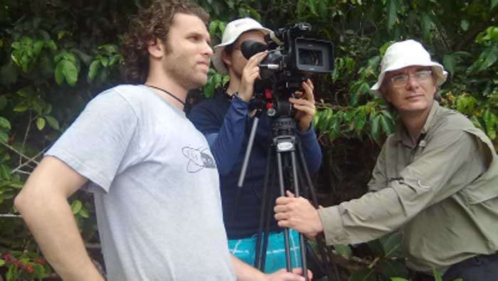 Robby Rotfeld from Wild About Animals TV SHOW films some monkeys at Manuel Antonio National Park