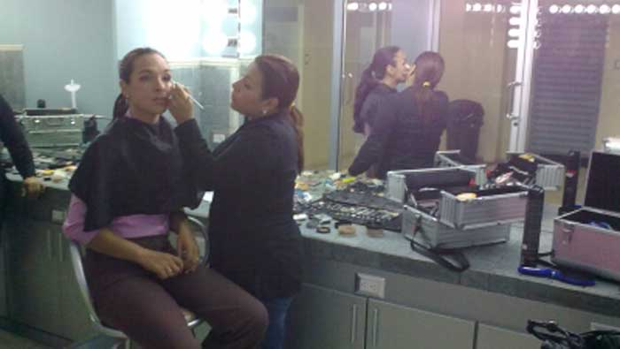 Make up artist Evelyn Granados prepares one of the hosts of a Scotiabank global production.