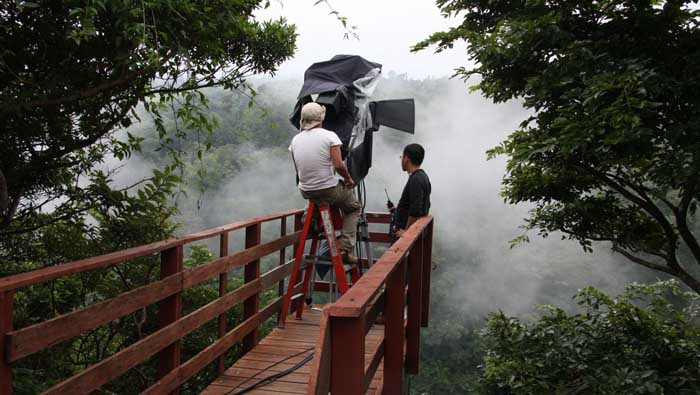 Dense clouds surround the camera as we prepare for a rainforest shot in the middle of the rainy season.(aprox 2000 meters above sea level) Photo Kaz yagi.