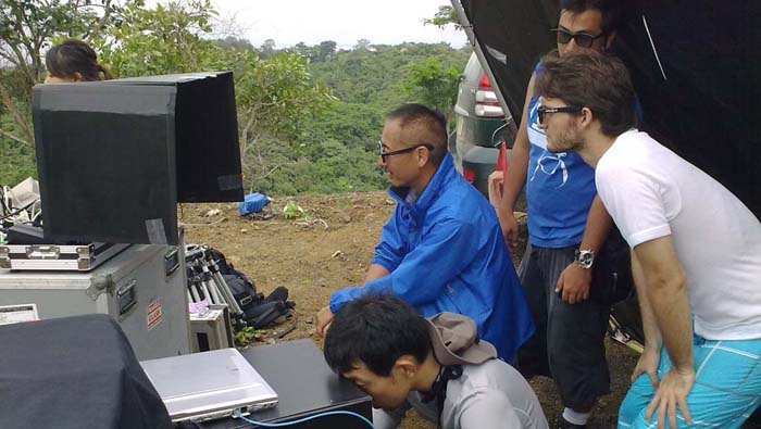 Kojima Masaru and his team, monitor with 3D eyeglasses, the three dimensional view of the forest on a shoot for Panasonic Japan.