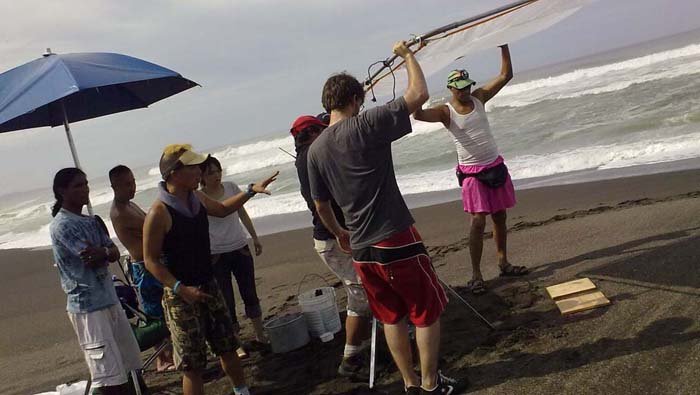 DIrector of Photography Nobuhiro Kuroishi prepares the griffolyn for a sequence on baby turtles.