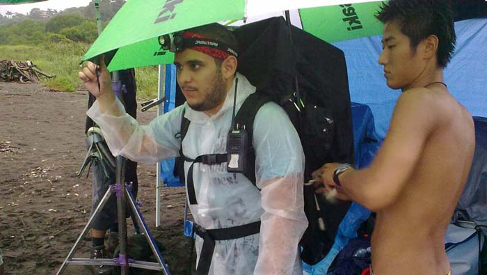 Video engineer Hiroshi Sato pack the 3D equipment on Ricardo's Cerdas back in a rainy day at Ostional beach.